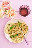 picture of purple rose  - Purple asparagus pancakes on a pink plate with roses - JPG