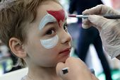 picture of face painting  - Kid with painting face at the amusement park - JPG