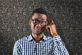 foto of confusing  - Confused casual businessman against black background - JPG