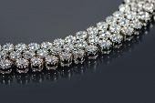 stock photo of precious stone  - Beautiful golden bracelet with precious stones on grey background - JPG