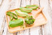 picture of aloe-vera  - Close up Aloe vera in wooden plate on wooden background - JPG