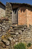 pic of stone house  - Old house of stone and brick in old mountain village - JPG