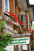 pic of guest-house  - Guest Rooms Sign on wooden board on a guest house in the Black Forest - JPG