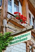 image of guest-house  - Guest Rooms Sign on wooden board on a guest house in the Black Forest - JPG