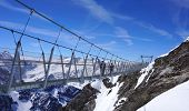 foto of tit  - Suspended walkway over snow mountains Titlis Engelberg Switzerland - JPG