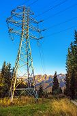 pic of power transmission lines  - Electric power transmission tower against blue sky - JPG