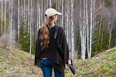 foto of hunter  - Woman hunter with gun in spring forest - JPG