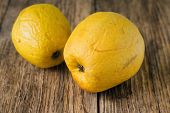 picture of significant  - Horizontal photo of two overripped yellow apples placed on old worn wooden table - JPG
