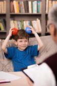 stock photo of psychologist  - Little boy talking with psychologist - JPG