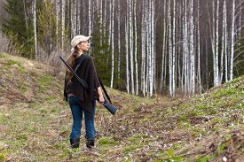 pic of hunter  - Woman hunter with gun in spring forest - JPG