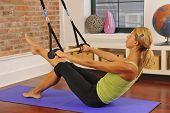 Blond Exercising Pilates Bar