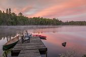 Постер, плакат: Cottage Dock On A Canadian Lake At Dawn At Dawn