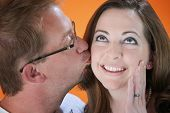 Man Kisses Woman