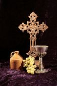 foto of chalice antique  - Still life photograph of a brown rustic cross with antique jug - JPG