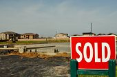 Sold Sign With New Homes In The Background