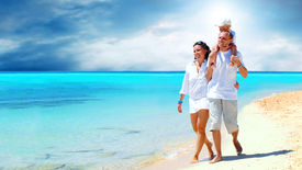 foto of family vacations  - View of happy young family having fun on the beach - JPG