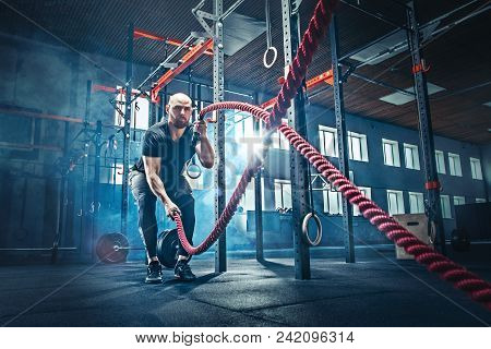 poster of Men With Battle Rope Battle Ropes Exercise In The Fitness Gym. Crossfit Concept. Gym, Sport, Rope, T