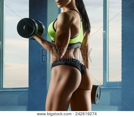 poster of Cropped Photo Of Strong Fit Model Training In Gym , Doing Fitness Exercises With Heavy Dumbbells. Ha