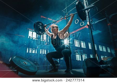 poster of Fit Young Woman Lifting Barbells Working Out At A Gym. Sport, Fitness, Weightlifting, Bodybuilding,