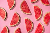 Watermelon pattern. Sliced watermelon on white background. Flat lay, top view poster