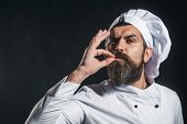 Serious Bearded Chef, Cook Or Baker Gesturing Excellent. Male Chef In White Uniform With Perfect Sig poster