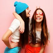 lifestyle, people and friendship concept - happy smiling pretty teenage girls or friends hugging ove poster