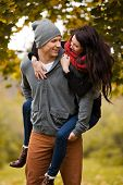 Romantic young couple in love frolicking in a park