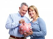 pic of save money  - Happy senior couple with piggy bank - JPG