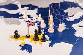 Chess Pieces And Flags On An European Map Focused In The Black Uk King And Islands. Brexit Negociati poster