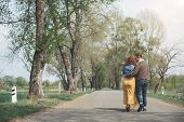 Romance Can Be In Any Age. Happy Middle-aged Loving Couple Enjoying Walk Along Alley In The Nature.  poster