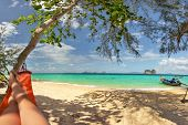 Legs Of Man Laying In Red Hammock In Tree Shade With Fine Sand Beach Below And View To Postcard Perf poster