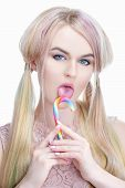 Beautiful Girl Model Blonde With Colored Dyed Hair And Bright Make-up, Over White Background Licking poster