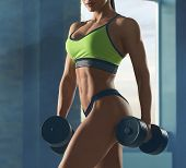 Close Up Of Strong Womans Body With Muscles. poster