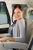 Executive Woman Manager Sitting In Car Backseat