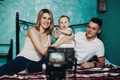 Blogging, Social Media, Mother Blogger. Happy Family With Baby Daughter Recording A Video For Blog.  poster