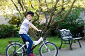 Happy School Kid Boy Having Fun With Riding Of Bicycle. Active Child With Safety Helmet Making Sport poster
