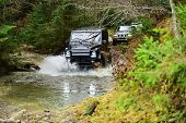 Suv Or Offroad Cars Crossing Water Stream. Car Racing With Creek On Way. Extreme Driving, Competitio poster