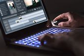 Video Editing With Laptop. Professional Editor Adding Special Effects Or Color Grading Footage For C poster