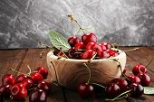 Cherry. Red Fresh Cherries In Bowl And A Bunch Of Cherries On The Table poster