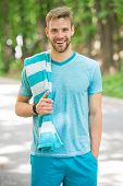 Man Athlete With Towel After Running Outdoor, Nature Background. Athletic Man Training In Park. Spor poster