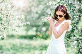 Spring Mood, Beautiful Woman Smell Flowering Tree, Enjoying Nature, White Floral Garden. Beautiful W poster