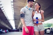 Couple Jogging And Running Outdoors In Nature poster