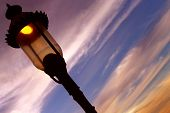 The Street Lamp At The Sunset