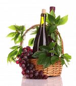 red wine and grapes in a basket isolated on white