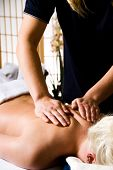 stock photo of massage therapy  - woman getting a good massage at a day spa - JPG