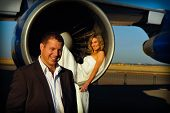 sexy young adult wedding couple laying inside the engine intake of Boeing passenger aircraft with gr