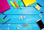 School Supplies In The School Desk, Stationery, School Concept, Blue Background, Creative Chaos, Spa poster