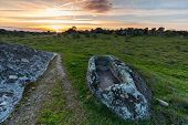 Sunset In The Barruecos Natural Area. Spain. In The Foreground There Is An Anthropomorphic Tomb Of S poster