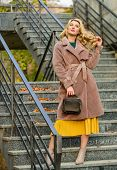 Girl Warm Coat Stand Urban Stairs Background. Create Fall Outfit To Feel Comfortable And Pretty. Aut poster