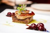 stock photo of liver fry  - Fried foie gras with cherry sauce and figs